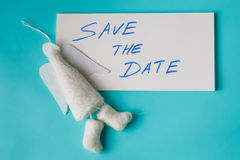 Felt angel with message save the date Royalty Free Stock Photography