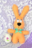 Felt beige rabbit and an decoupage egg - Easter symbols Stock Photography