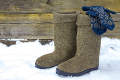 Felt boots and mittens. Stock Photo