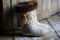 Felt boots near the wooden door Stock Images
