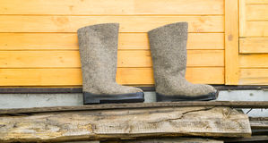 Felt boots near wooden wall stock photography