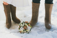 Felt boots in snow Royalty Free Stock Photo
