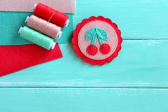 Felt brooch hand embroidered summer. Felt cherry ornament. Set of multicolored threads. Set of colored felt sheets. Easy craft Stock Image
