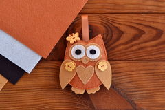 Felt brown owl. Shabby chic style. Kids crafts. Felt sheets. Brown wooden table. Sewing crafts. Easy crafts from felt. Felt sewing royalty free stock photography