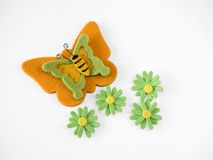 Felt butterfly and flowers. White background royalty free stock image