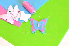 Felt butterfly, paper templates, thread, needle, pins, beads. Sewing kit, tutorial Royalty Free Stock Image