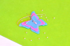 Felt butterfly, thread, needle, beads. Sewing set, tutorial. Kids summer crafts. Sewing tutorial. Children's sewing instruction stock photos