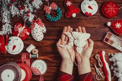 Felt Christmas decorations. On the wooden table - woman is preparing for handmade royalty free stock photo