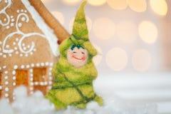Felt christmas tree. And gingerbread house Stock Photo