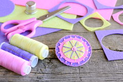 Felt circle flower decorated with beads. Handmade flower felt crafts, scissors, thread, colored felt sheets, thimble Royalty Free Stock Photography