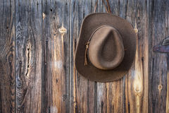Felt cowboy hat hanging on barn wall Royalty Free Stock Photo