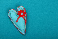 Felt craft and art teal heart with flower on blue