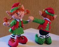 Felt decoration in retro style - dansing christmas elves. Cute close-up of christmas toys. Happy new year hand made