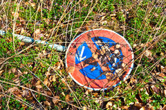 Felt down traffic sign no standing at any time lying in the grass Stock Photography