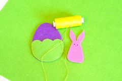 Felt Easter egg and bunny ornament. How to make handmade Easter ornament. Sewing craft concept. Kids sewing. Step. Felt Easter egg, handmade decor. DIY Easter royalty free stock photography