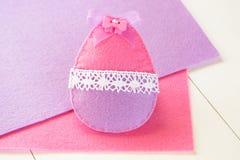 Felt Easter egg. Simple Easter crafts for kids. DIY crafts idea. Easter egg crafts for kids. Felt spring crafts. Felt Easter eggs. Easter crafts. Easter holidays stock image