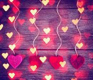 Felt fabric valentine's hearts hanging on rustic driftwood Royalty Free Stock Photo
