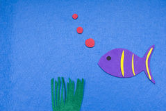 Felt Fish Blowing Bubbles. A felt fish blows bubbles Royalty Free Stock Photo