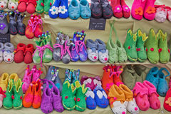 Felt Footwear. Colorful felt slippers on display at an Ebglish market Stock Photos