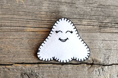 Felt Halloween ghost ornament  on old wooden background. Closeup Royalty Free Stock Images
