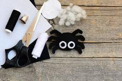 Felt Halloween spider ornament, scissors, thread, needle, thimble, paper templates, filler, white and black felt sheets Stock Image