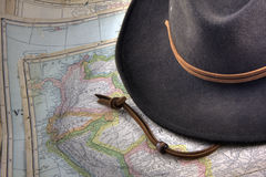Felt hat over vintage, warn out map of South Ameri Royalty Free Stock Photo