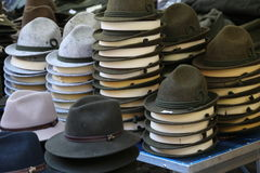 Felt hats of all sizes for sale in stand of flea market Royalty Free Stock Image