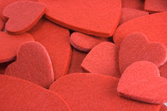 Felt heart background. Red felt hearts as a background stock images