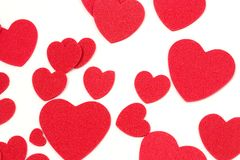 Felt Hearts. Many red, felt, hearts - in various sized Stock Image