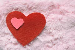 Felt hearts on pink fur texture. Valentines Day background or greeting card concept.  stock photo
