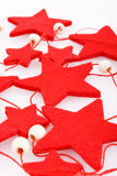 Felt holiday red stars. Isolated on the white Stock Images