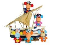 Felt monkeys on the Ship Stock Photos