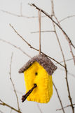 Felt Ornaments. Cute nature themed bird house felt ornament hanging from a tree branch Royalty Free Stock Images