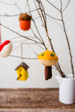 Felt Ornaments. Cute nature themed felt ornaments hanging from a tree branch Royalty Free Stock Photo