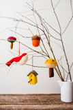 Felt Ornaments. Cute nature themed felt ornaments hanging from a tree branch Royalty Free Stock Image