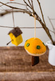 Felt Ornaments. Cute nature themed felt ornaments hanging from a tree branch Royalty Free Stock Images