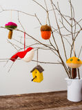 Felt Ornaments. Cute nature themed felt ornaments hanging from a tree branch Stock Image