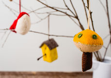 Felt Ornaments. Cute nature themed felt ornaments hanging from a tree branch Royalty Free Stock Photos