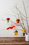 Felt Ornaments. Cute nature themed felt ornaments hanging from a tree branch Stock Photo