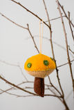 Felt Ornaments. Cute nature themed mushroom felt ornaments hanging from a tree branch Royalty Free Stock Photography