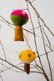 Felt Ornaments. Cute nature themed mushroom felt ornaments hanging from a tree branch Stock Photos