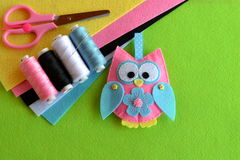 Felt owl embellishment. Felt owl toy. How to make a pretty felt owl - kids DIY crafts tutorial. Sheets of colored felt, scissors. Kids crafts tutorial. Sheets of Royalty Free Stock Photos