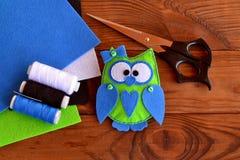 Felt owl embellishment. How to make a cute felt owl toy - kids crafts tutorial. Sheets of colored felt, scissors, thread, needle. Felt owl ornament. Felt owl Stock Photos