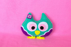 Felt owl. Handmade felt colorful owl toy on pink background Royalty Free Stock Photography