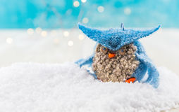 Felt Owl Ornament in Snow High Contrast. Against blue background Stock Photo