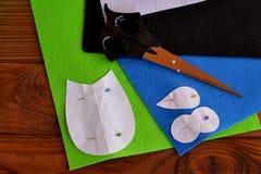 Felt owl pattern, scissors. Felt owl embellishment. Felt owl toy. How to make a cute felt owl toy. Kids DIY crafts tutorial. Sewing set. Sewing concept. Felt Stock Images
