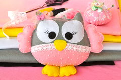 Felt owl toy, pincushion, sewing kit, scissors. Sewing concept. Stock Photos