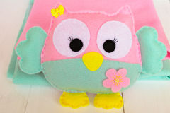 Felt owl on a white wooden background, rolls of pink and blue felt Royalty Free Stock Images