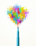 Felt pen close-up with colored paint splashes Stock Photos