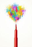 Felt pen close-up with colored paint splashes Royalty Free Stock Images